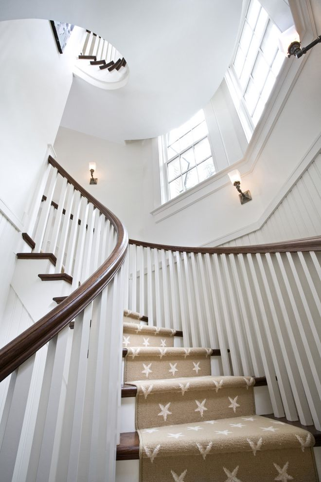 Carpet Runners by the Foot with Traditional Staircase  and Beadboard Beige Curved Staircase Dark Stained Wood Staircase Runner Stairwell Stars Wainscot Wall Sconce White Windows