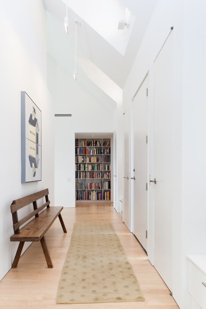 Construction Jobs Lafayette La with Farmhouse Hall Also Artwork Bench Seat Bookshelves Carpet Runner Hallway Runner Inset Doors Library Wall My Houzz Natural Wood Floor Skylights White Walls