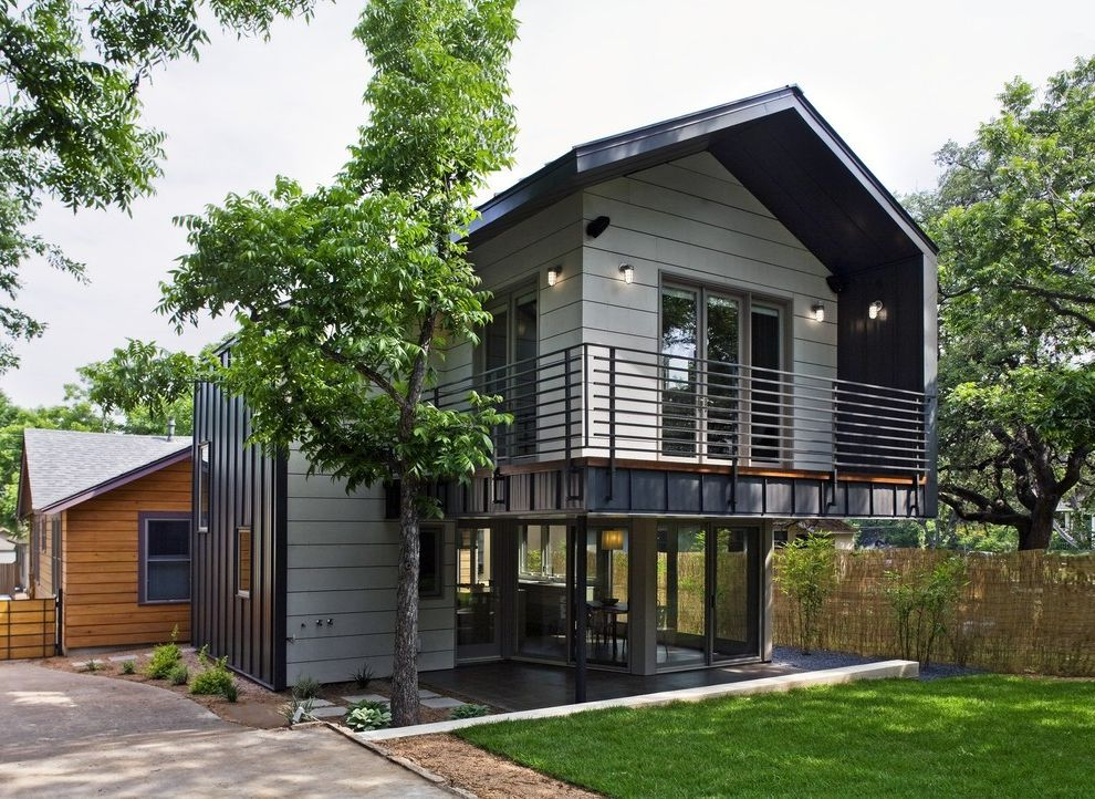 Corepower Yoga Austin   Contemporary Exterior  and Cantilever Covered Patio French Doors Glass Doors Grass Handrail Lawn Metal Railing Metal Siding Outdoor Lighting Pavers Sconce Sliding Doors Turf Wall Lighting Wood Siding
