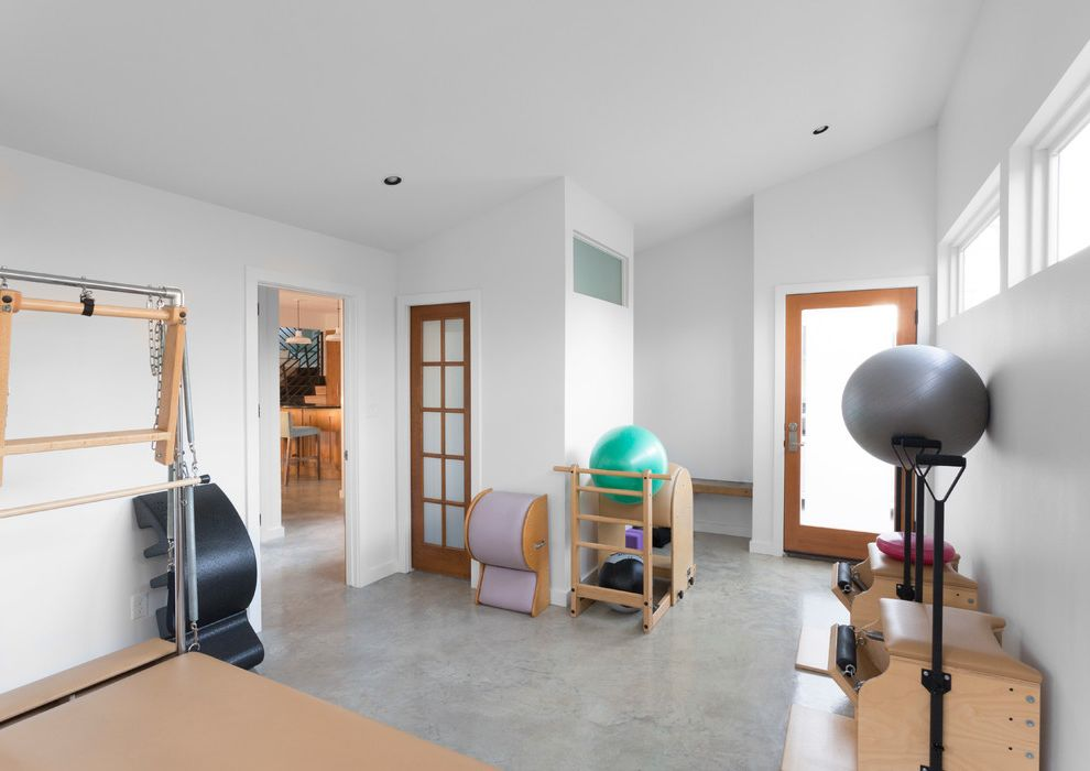 Corepower Yoga Austin   Contemporary Home Gym  and Austin Contemporary Contemporary Design Green Design Home Gym Modern Modern Design Pilates Equipment Pilates Studio Polished Concrete Floor Recycled Studio Sustainable Sustainably Designed
