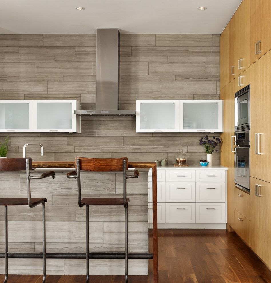 Corepower Yoga Austin   Contemporary Kitchen  and Austin Modern Gray Kitchen Kitchen Island Light Wood Cabinets Live Edge Counter Mid Century Modern Modern Vent Hood Rustic Counter Stool Tile Wall Warm Contemporary Waterfall Counter White Cabinets