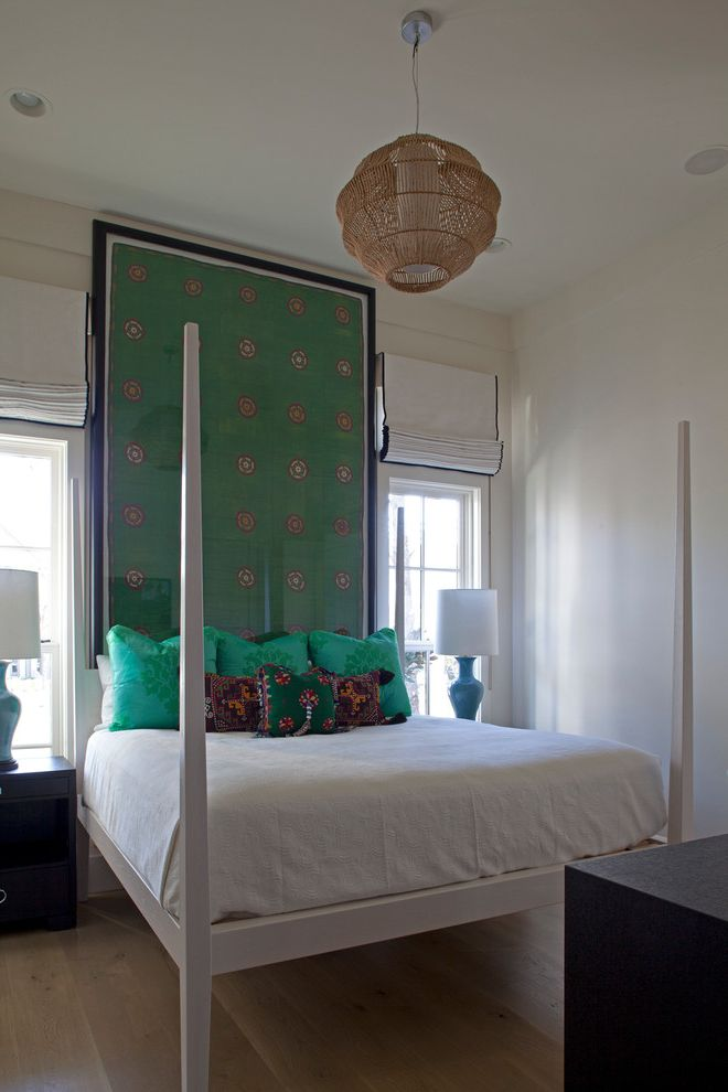 Corepower Yoga Austin with Eclectic Bedroom  and Bedding Green Accents Large Wall Art Light Hardwood Floors Muntins Nightstands Pendant Light Pillows Recessed Lighting Table Lamp Tall Bed Posts White Bed White Wall Window Shades Windows
