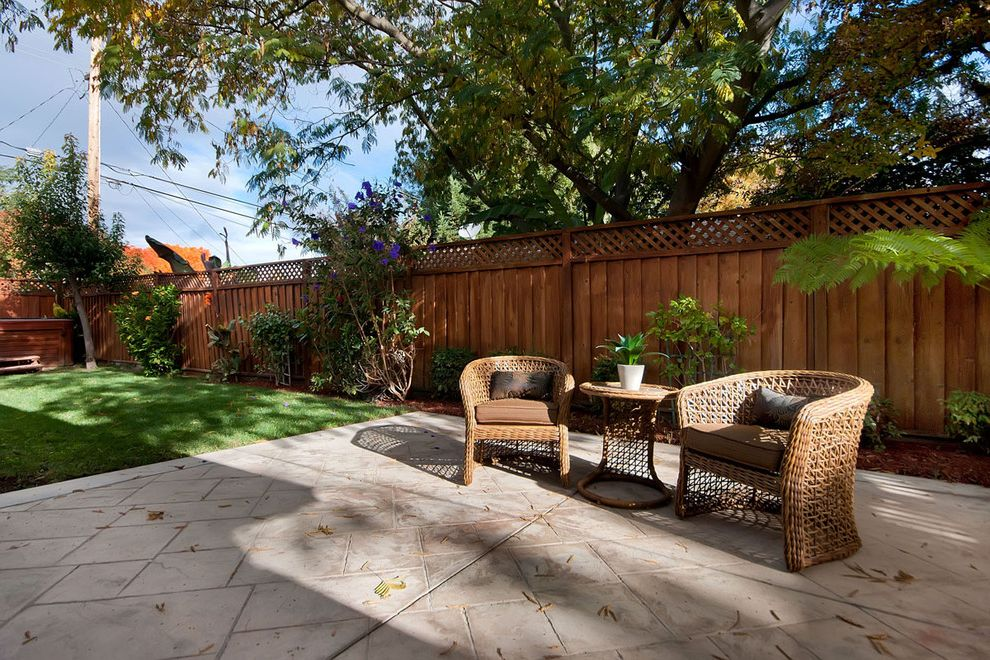 Corner Lot Fence Ideas   Traditional Patio Also Concrete Patio Fence Garden Fence Garden Seating Grass Lawn Patio Table Wicker Chair Wood Fence