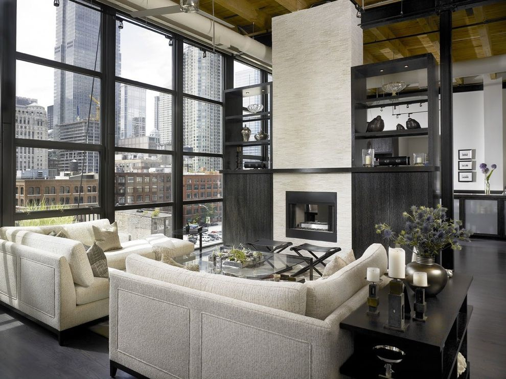 Down Filled Sectional   Industrial Living Room  and Built in Shelves Ceiling Lighting Corner Sofa Dark Floor Glass Wall High Ceilings Loft Modern Fireplace Sectional Sofa Symmetry Track Lighting Urban View Wood Ceiling Wood Flooring