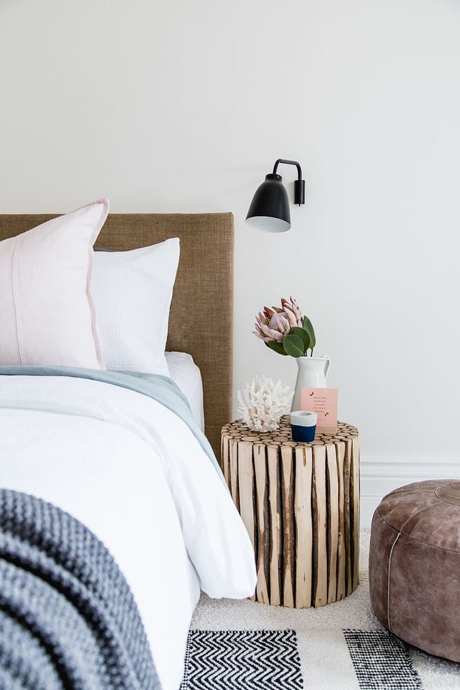 Down Filled Sectional   Scandinavian Bedroom  and Black Wall Sconce Blue Throw Blanket Bright Bedroom Chic Bedroom Elegant Master Bedroom Gray Ottoman Gray Pouf Natural Headboard White Pitcher White Sheets Wood Stump
