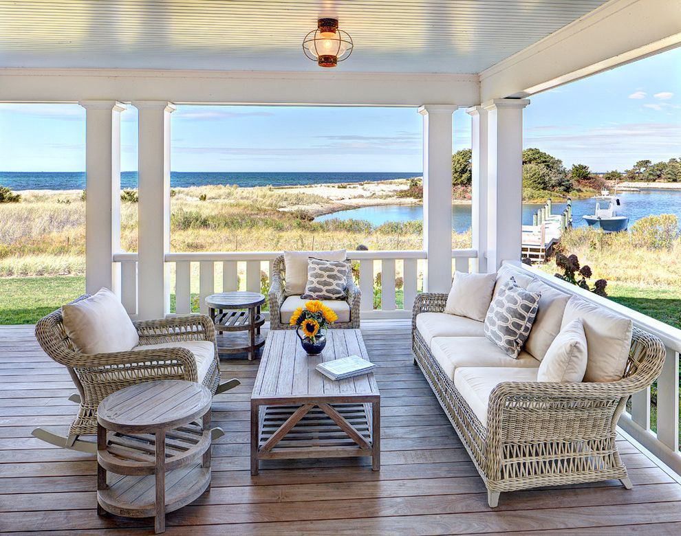 Dream World Furniture with Beach Style Porch  and Ceiling Light Marthas Vineyard Outdoor Furniture Outdoor Lighting Outdoor Seating Waterfront White Railing Wicker Furniture
