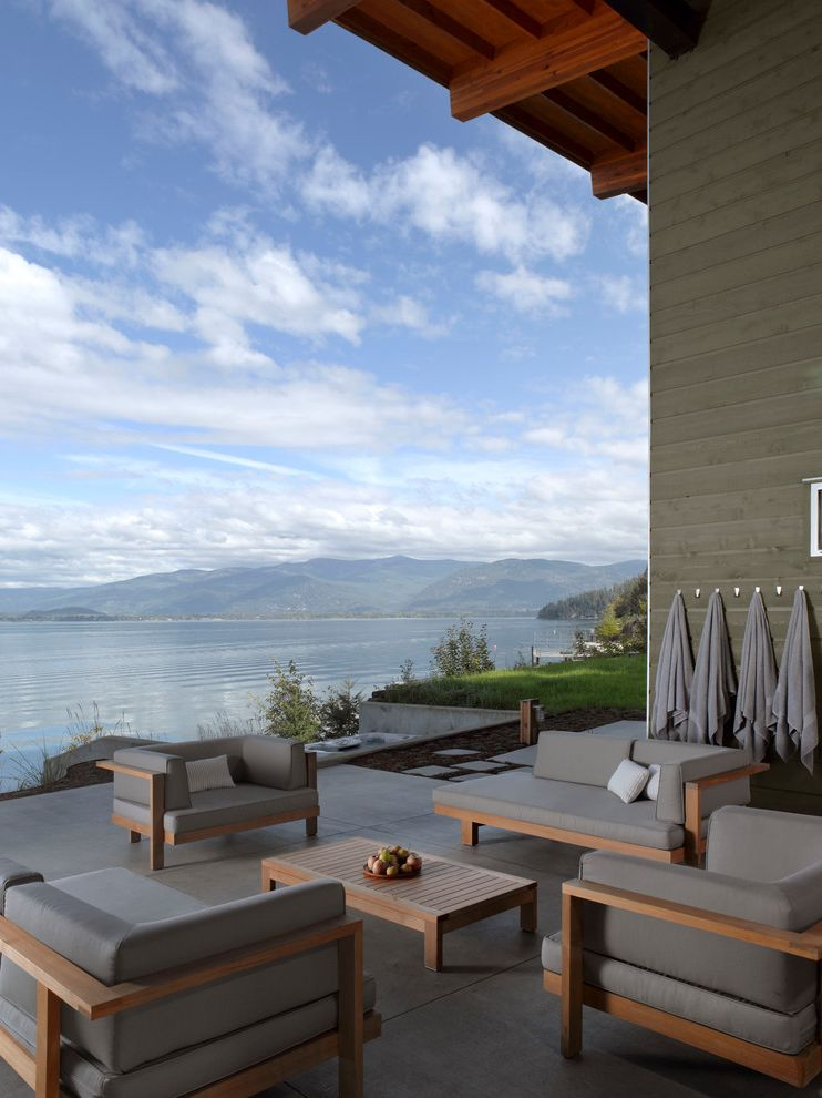 Dream World Furniture with Modern Patio  and Beach House Concrete Pavers Covered Patio Exterior Garden Furniture Gray Gray Patio Furniture Grey Lake House Landscape Patio Wood Beam Wood Garden Furniture Wood Table