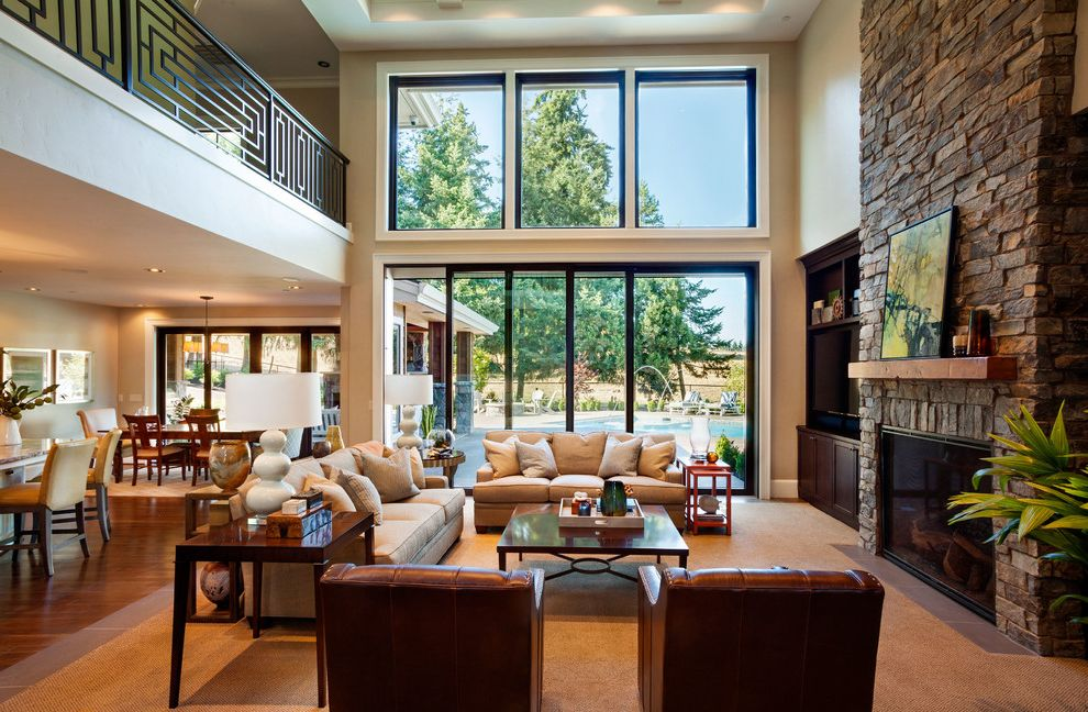 Dream World Furniture with Transitional Living Room  and Balcony Dark Wood End Table Dining Great Room Large Windows Living Square Coffee Table Stacked Table Lamp Stone Fireplace Tan Carpet Tan Sofa White Table Lamp