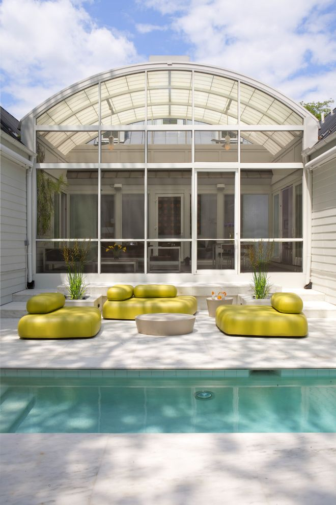 Dream World Furniture with Transitional Pool Also Accent Color Arched Roof Glass Wall Lounge Area Minimal Neon Green Outdoor Steps Patio Furniture Planters Roof Line Stone Paving Sunroom