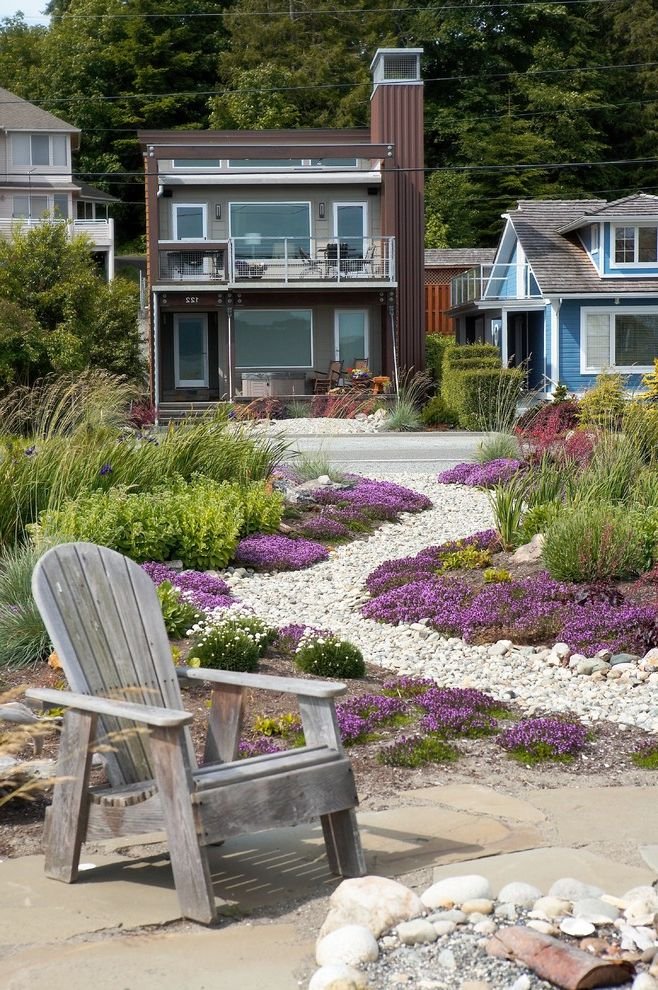Drought Resistant Ground Cover with Beach Style Landscape Also Adirondack Chair Beach House Coastal Dry Creek Dry River Grasses Gravel Groundcover Mass Planting Path Patio Furniture Purple Flowers Walkway