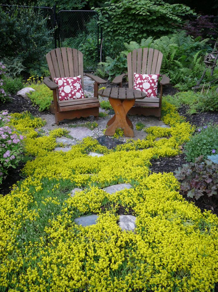 Drought Resistant Ground Cover with Traditional Landscape  and Bushes Gardens Ground Cover Muskoka Chairs Shrubs Sitting Area Stone Pathway Stone Walkway Wood Adirondack Chair Wood Side Table Yellow Flowers