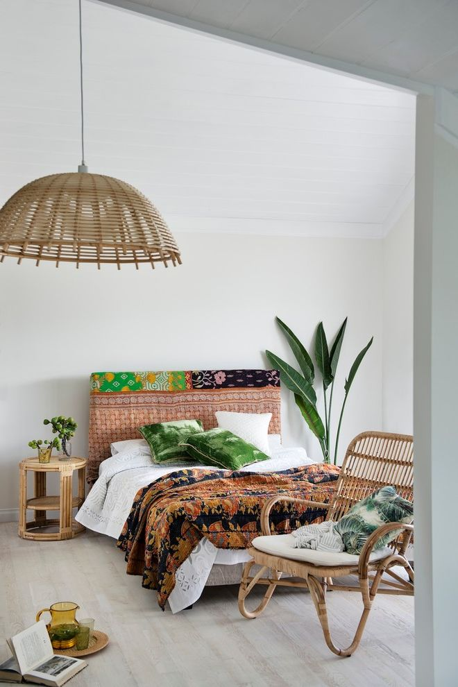 East Beach Marina Apartments with Tropical Bedroom  and Asian Fabric Pattern Bamboo Ceiling Lamp Bamboo Furniture Green Pillows Indoor Plants Lounge Chair Slanted Door Frame White Walls