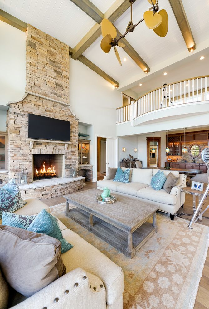 Echelon Furniture   Beach Style Living Room Also Balcony Beige Couch Blue and Gray Accents Blue Pillow Catwalk Coastal Fireplace Gray Pillow Linen Couch Palm Ceiling Fan Rustic Rustic Coffee Table Stone Fireplace Wood Beams Wood Coffee Table Wood Floors
