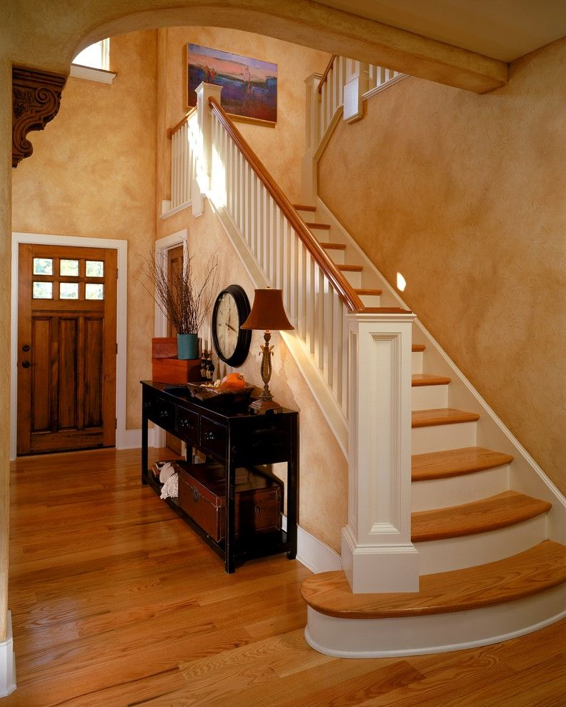 Entry Way Tables   Traditional Entry  and Banister Console Table Entry Table Faux Finish Front Door Handrail Staircase Table Lamp Wall Clock Wood Door Wood Flooring Wood Railing
