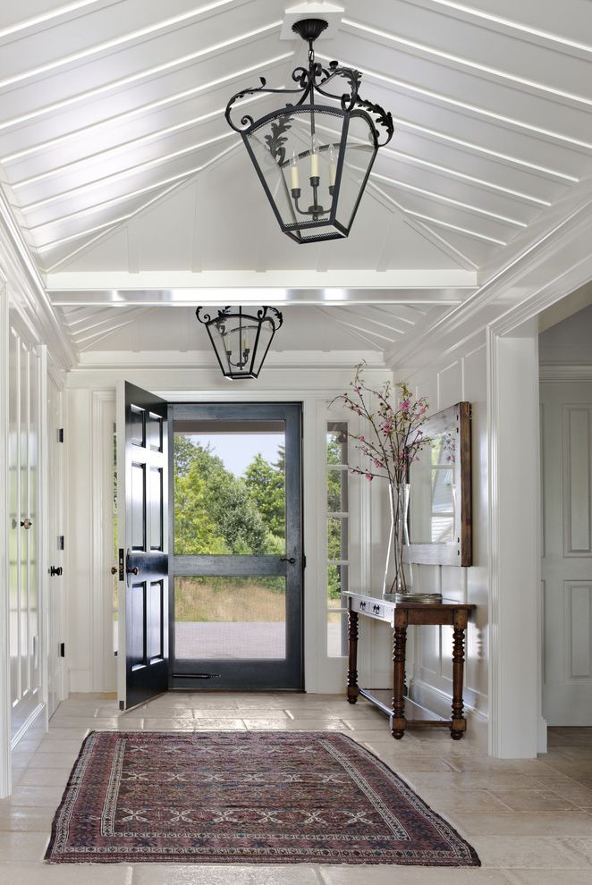 Entry Way Tables with Farmhouse Entry  and Entryway Hanging Lantern Interior Entry Lantern Large Vase Screen Door Stone Floor Traditional Area Rug White Ceiling White Wall Wood Console Table