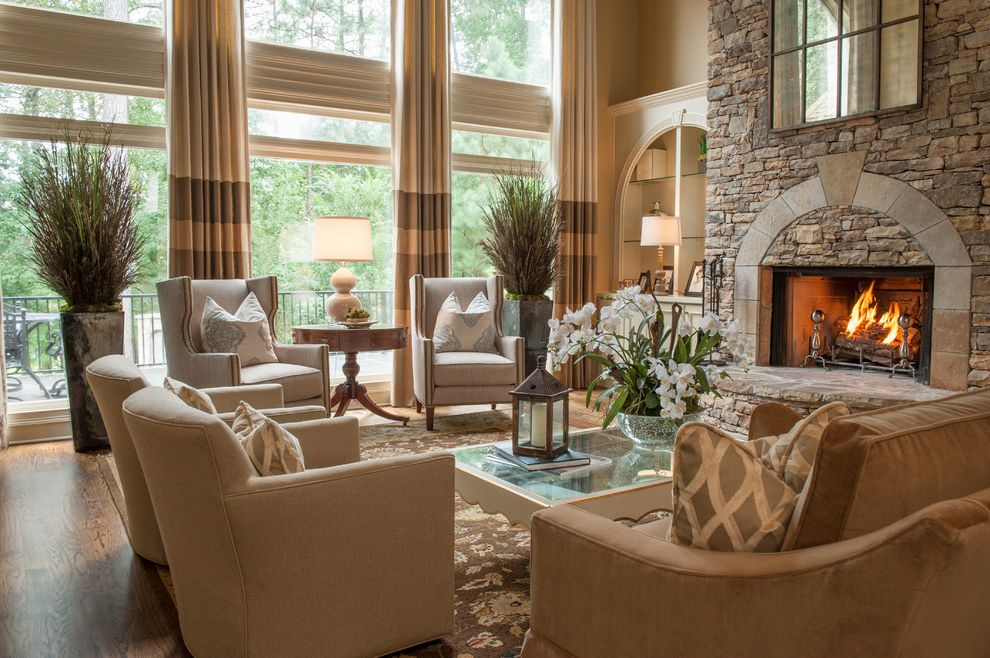 Ethan Allen Portland Maine   Traditional Living Room  and Arch Area Rug Built in Cabinets Fireplace Glass Shelves Keystone Mirror Neutral Colors Potted Plants Stonework Tall Ceilings Window Treatment Wing Chairs Wood Floor
