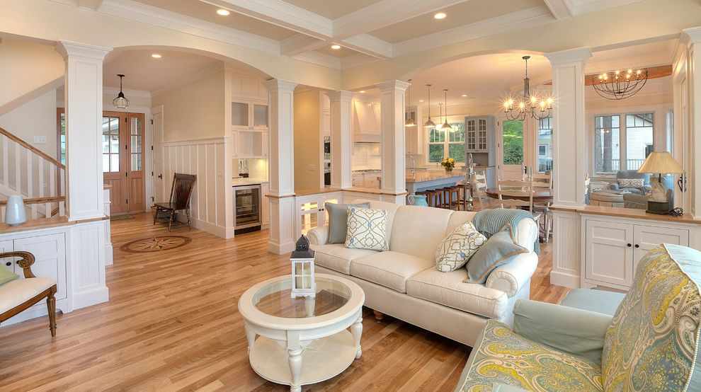 Ethan Allen Portland Maine   Traditional Living Room  and Armchairs Blues Built Ins Chandelier Coffered Ceiling Columns Glass Coffee Table Light Yellow Natural Wood Seating Area Sofa Wainscoting Wood Entry Doors Wood Floor