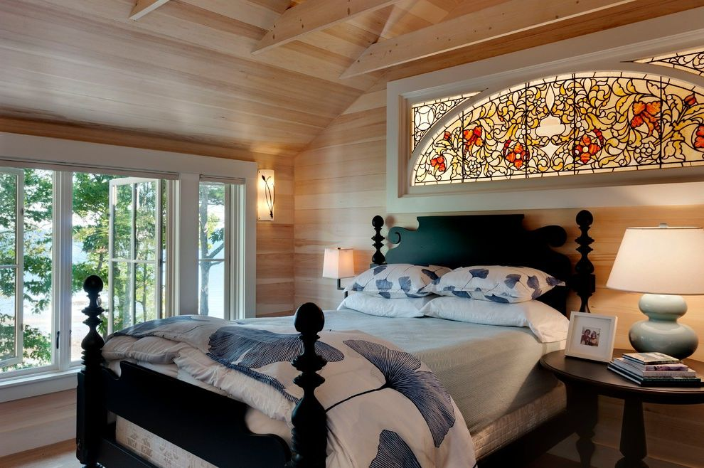 Ethan Allen Portland Maine with Beach Style Bedroom Also Antique Casement Windows Cottage Exposed Beams Four Poster Bed Large Windows Maine Natural Wood Oceanfront Side Table Stained Glass Table Lamp Water View White Casing Wood Paneling