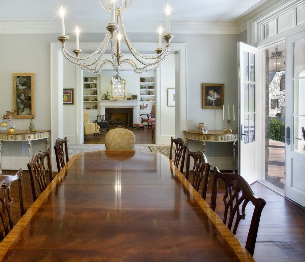 Ethan Allen Portland Maine with Traditional Dining Room  and Artwork Chandelier Curved Edge Table Fireplace French Doors Half Moon Side Table Host Chair Moulding Transom Window White Wood Dining Chairs Wood Dining Table Wood Flooring