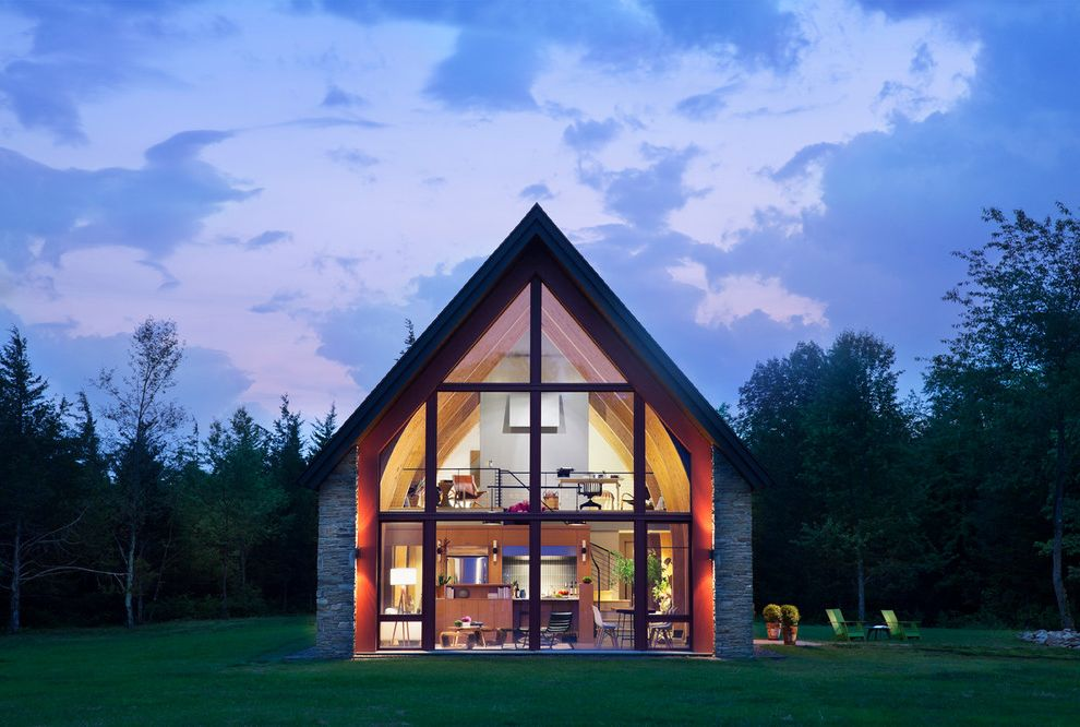 Four Seasons Heating and Cooling Ripoff with Contemporary Exterior  and a Frame Adirondack Chairs Country Curved Buttresses Curved Cathedral Like Glass Wall Field Glass House Loft Passive House Potted Plants Stone Sustainable Tripod Lamp Woodsy