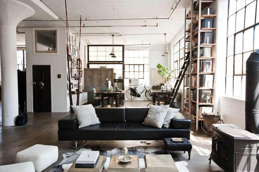Furniture Warehouse Brooklyn   Industrial Living Room  and Black and White Black Sofa Bookcase Columns Concrete Floors Decorative Pillows Great Room Industrial Industrial Windows Loft Sprinklers Throw Pillows Wood Burning Stove