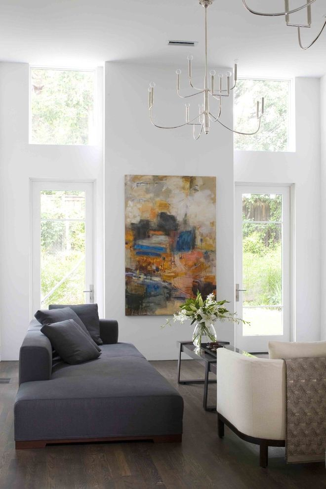 Habitat for Humanity High Point Nc   Modern Living Room  and Bare Bulb Chandelier Chandelier Clerestory Dark Floor Floral Arrangement Gray Couch High Ceiling Modern Art Neutral Colors Tan Armchair Wall Art Wall Decor Wood Flooring