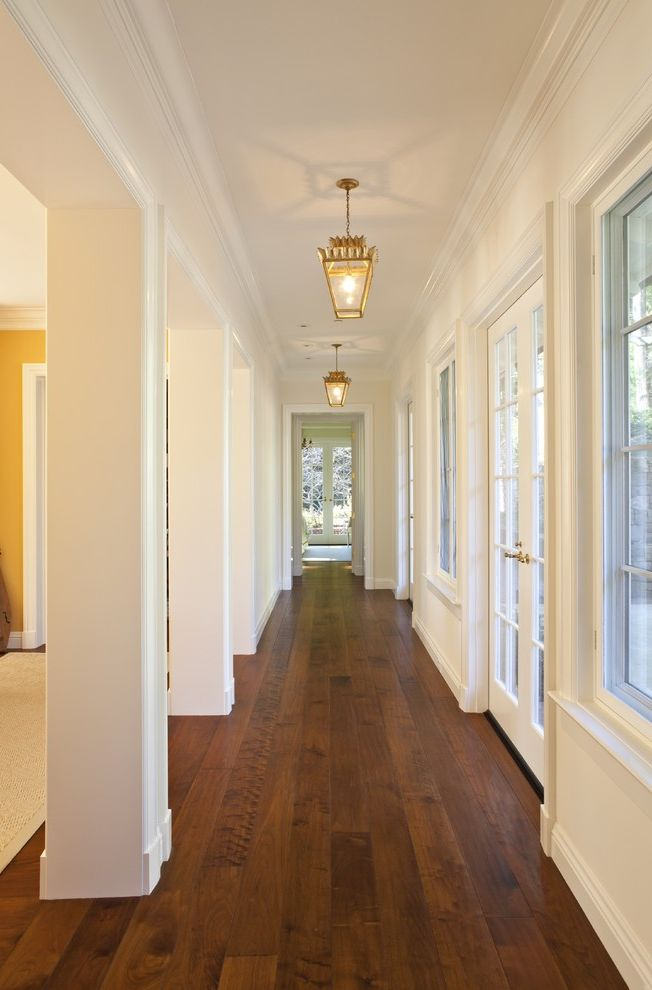 Hardwood Floors Tulsa with Traditional Hall  and Baseboards Columns Crown Molding Dark Floor French Doors Lanterns White Wood Wood Flooring Wood Molding