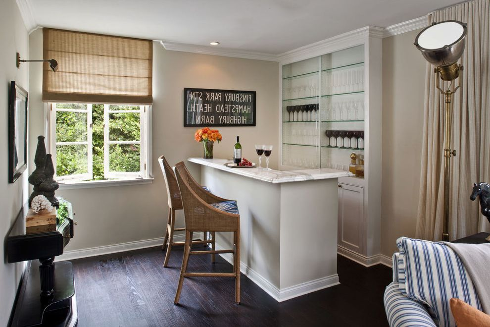 Home Bar Honolulu   Transitional Home Bar  and Bar Beige Curtain Beige Roman Shade Black Console Table Blue and White Striped Sofa Built in Storage Dark Wood Floor Glass Shelves Gray Island Grey Island White Baseboard White Countertop Wicker Barstool