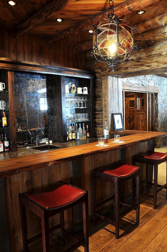 Home Bar Honolulu with Rustic Home Bar  and Bar Ceiling Lighting Exposed Beams Home Bar Lantern Nailhead Trim Recessed Lighting Red Leather Barstools Rustic Wet Bar Wood Ceiling Wood Countertops Wood Flooring