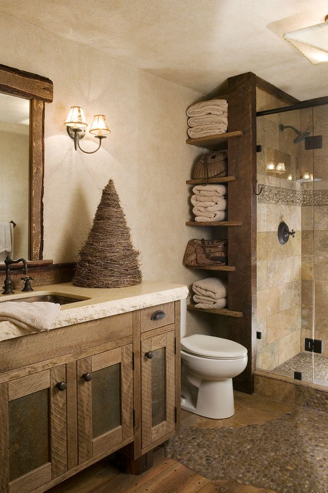 Houston Custom Installers with Rustic Bathroom Also Beige Countertop Ceiling Light Found Wood Framed Mirror Open Shelves Pebble Tile Reclaimed Wood Wall Sconce