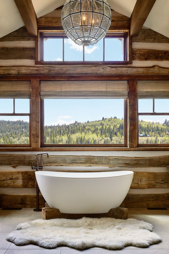 How to Clean a Stained Tub with Rustic Bathroom Also Fur Rug Master Bathroom Mountain Contemporary Mountain Home Mountain Modern Pendant Light Views Windows Wood Beams