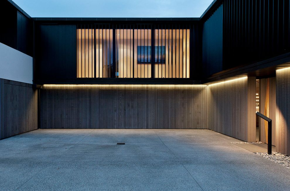 How to Fix a Garage Door Spring   Contemporary Exterior Also Backlighting Black and White Facade Courtyard Driveway Flat Roof Glass Walls Invisible Garage Doors Minimal Mixed Materials Outdoor Lighting Recessed Lighting