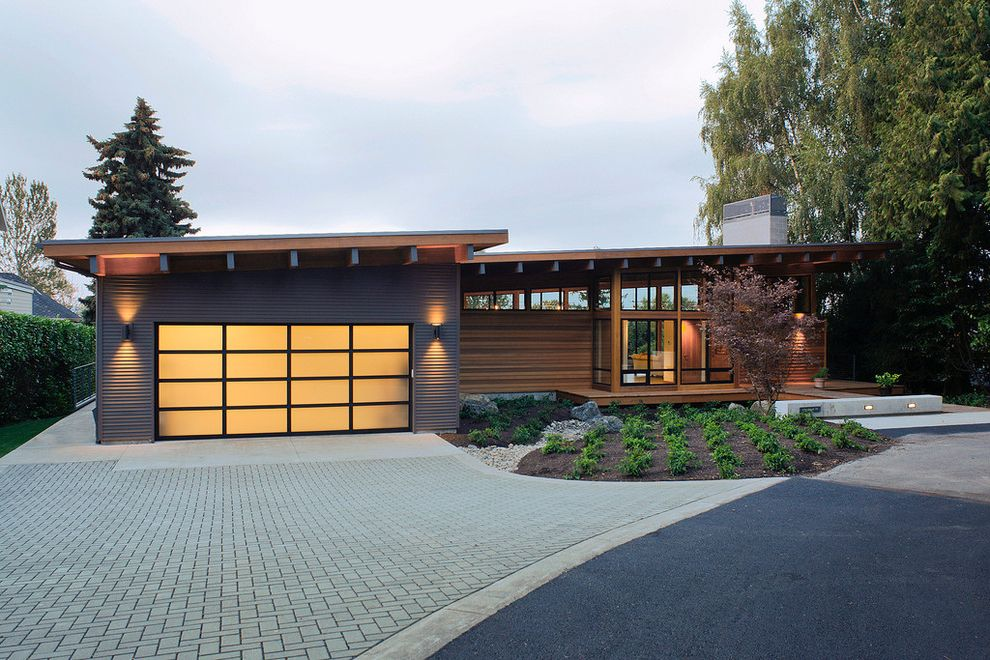 How to Fix a Garage Door Spring with Rustic Exterior Also Attached Garage Chimney Dusk Horizontal Siding Low Water Front Yard Mulch Outdoor Lighting Overhanging Eaves Paved Driveway Rafters Sloped Roof Translucent Garage Door Two Car Garage Xeriscape