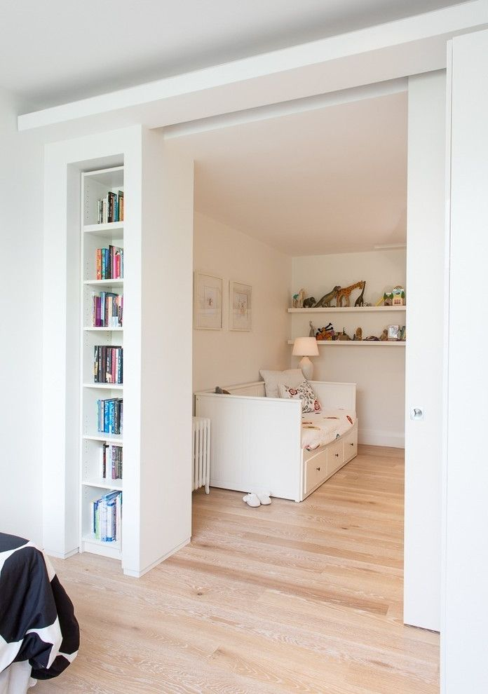 How to Knock Down a Wall   Contemporary Kids  and Daybed Floating Shelves Kids Bedroom Milne Pocket Door Radiator Built in Bookshelves Sliding Doors Toys Under Bed Drawers White Rooms