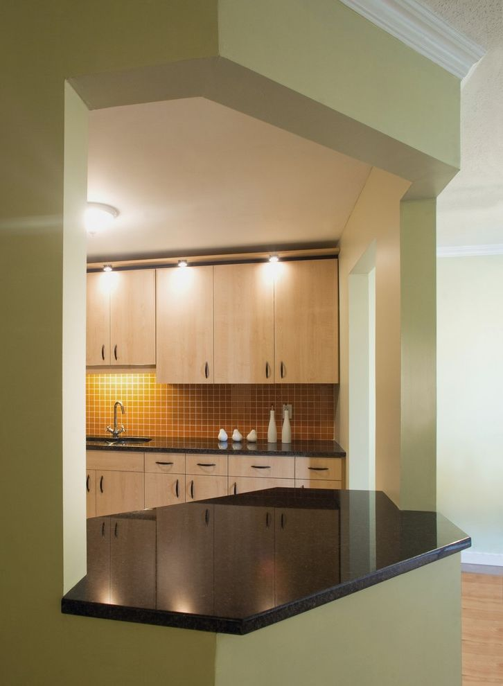 How to Knock Down a Wall   Eclectic Kitchen  and Ceiling Lighting Glass Tiles Green Walls Kitchen Hardware Sconce Tile Backsplash Under Cabinet Lighting Wood Cabinets Wood Flooring Yellow Tiles
