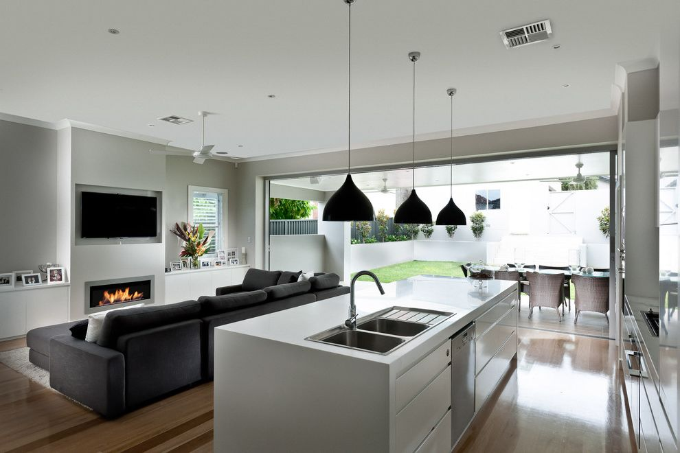 How to Knock Down a Wall with Contemporary Living Room Also Backyard Black Sofa Ceiling Fan Flat Panel Cabinets Gray Walls Indoor Outdoor Kitchen Island Outdoor Entertaining Pendant Lights Wood Floor