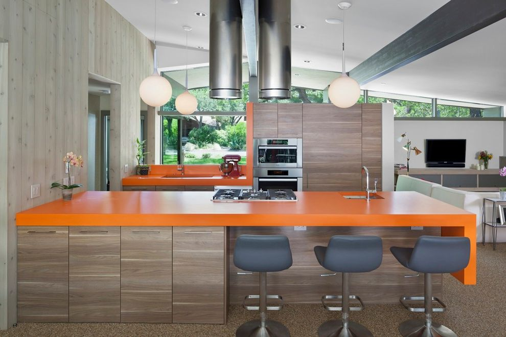 How to Knock Down a Wall with Midcentury Kitchen Also Clean Lines Cooktop Functional Gray Counter Stools Modern Orange Counter Pendant Lights Plastic Laminate Regional Modern Vents Walnut Veneer Wood Panel Wall