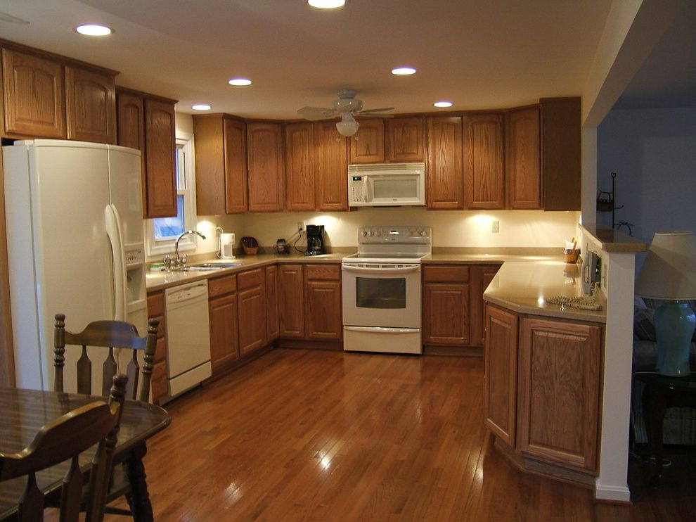 J and J Appliances Tulsa   Traditional Kitchen  and Knee Wall Oak Cabinets Structural Beam Under Cabinet Lights White Appliances