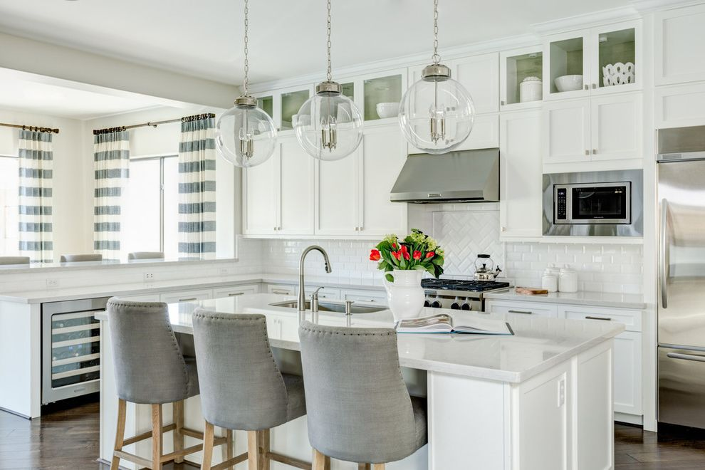 J and J Appliances Tulsa with Transitional Kitchen  and Clerestory Cabinets Glass Pendant Lights Gray Bar Stools Under Cabinet Refrigerator White Countertop Wine Refrigerator