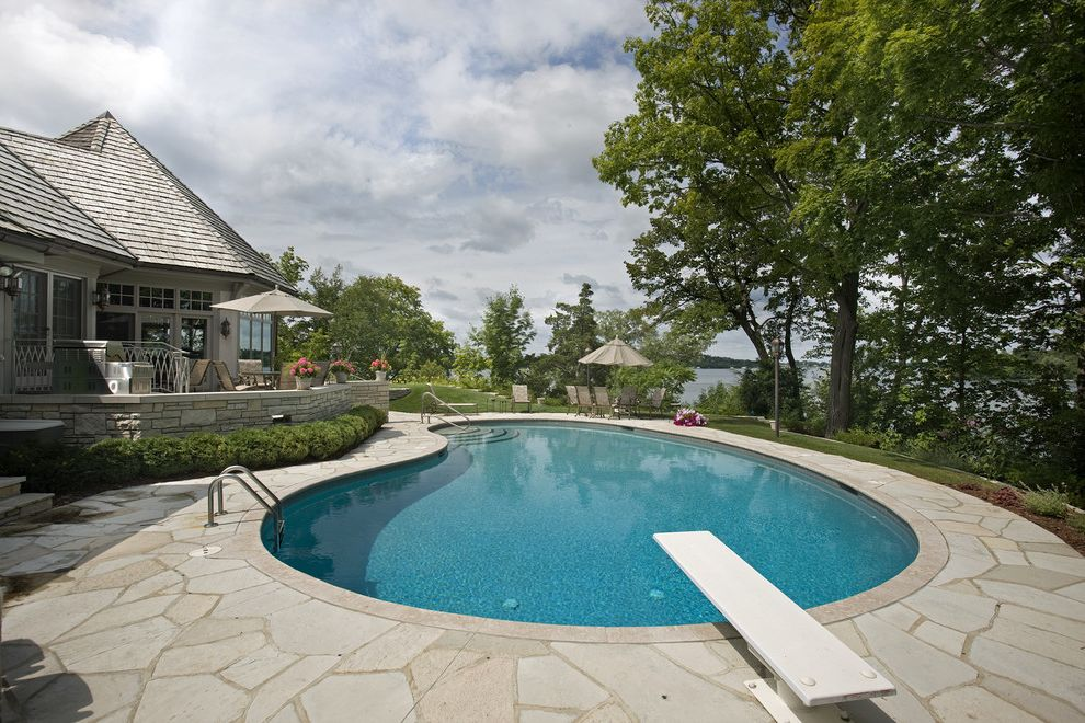 Kidney Shaped Couch with Traditional Pool  and Cedar Cedar Shake Roof Copper Copper Gutters Diving Board Kidney Pool Lake Minnetonka Marvin Windows Minnetrista Patio Paving Pool Deck Stone Paving Stone Pillars Terrace View Waterfront