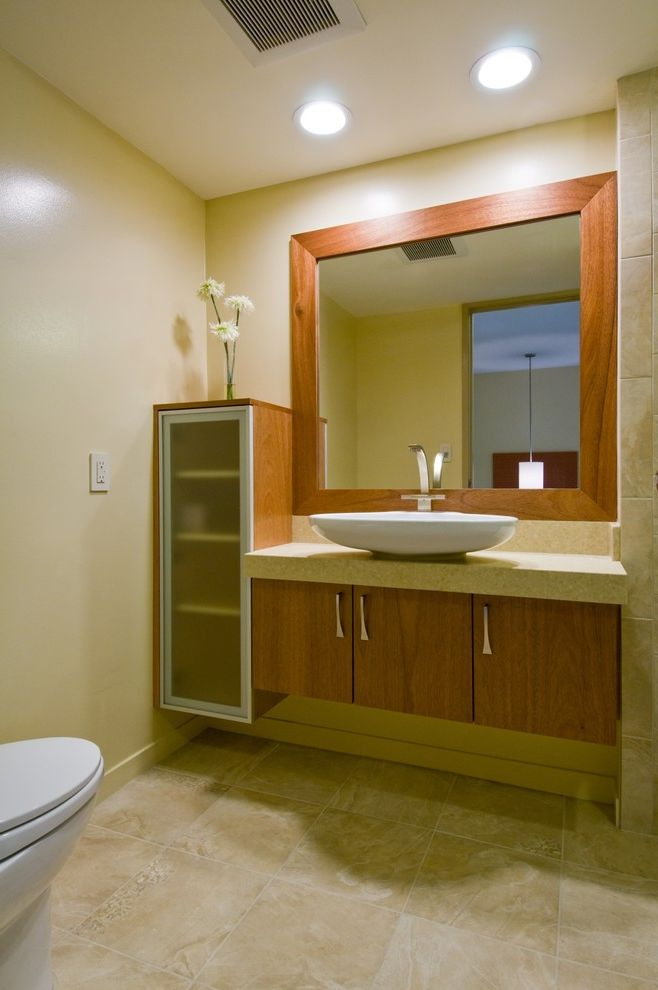 Liberty Towers Tulsa with Contemporary Bathroom  and Bath Fixtures Bathroom Mirror Ceiling Lighting Door Handles Floating Vanity Framed Mirror Frosted Glass Glass Front Cabinets Minimal Neutral Colors Stone Flooring Storage Tile Flooring Vessel Sink