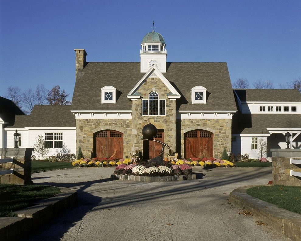 Liberty Towers Tulsa with Traditional Garage  and Carriage Door Circular Driveway Dormer Windows Eaves Entrance Entry Garage Door Garden Art Gravel Driveway Lantern Outdoor Lighting Planter Sculpture Statue Stone Wall White Wood Wood Siding Wood Trim