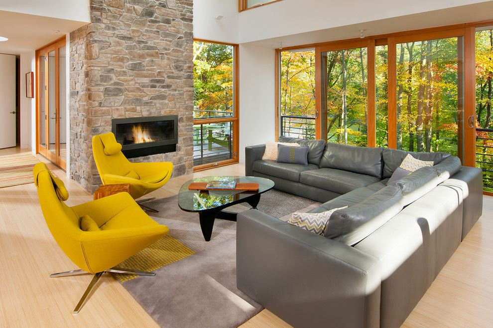 Light Gray Leather Sofa   Contemporary Living Room Also Balcony Deck Glass Coffee Table Gray Leather Sofa Nature Rug Sliding Glass Doors View Yellow Chairs