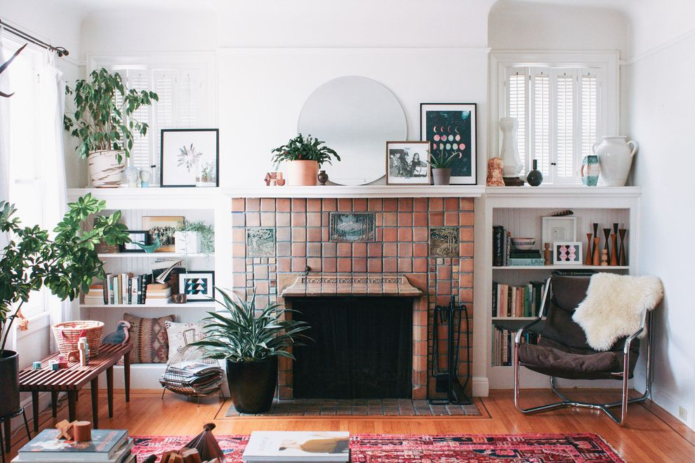 Lowes Air Filters with Eclectic Living Room  and Built in Bookcase Built in Shelves Indoor Plants Red Area Rug Round Mirror Terra Cotta Tile Fireplace White Shutters Wood Bench