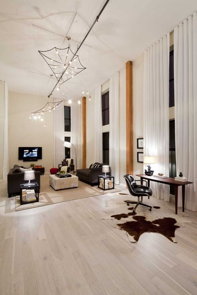 Lowes Engineered Flooring   Eclectic Living Room  and Accent Columns Cowhide Rug Curtains Dramatic Drapes Great Room High Ceilings Light Flooring Loft Modern Light Fixture Multiple Seating Areas Neutral Colors Open Floor Plan Venice Window Treatments