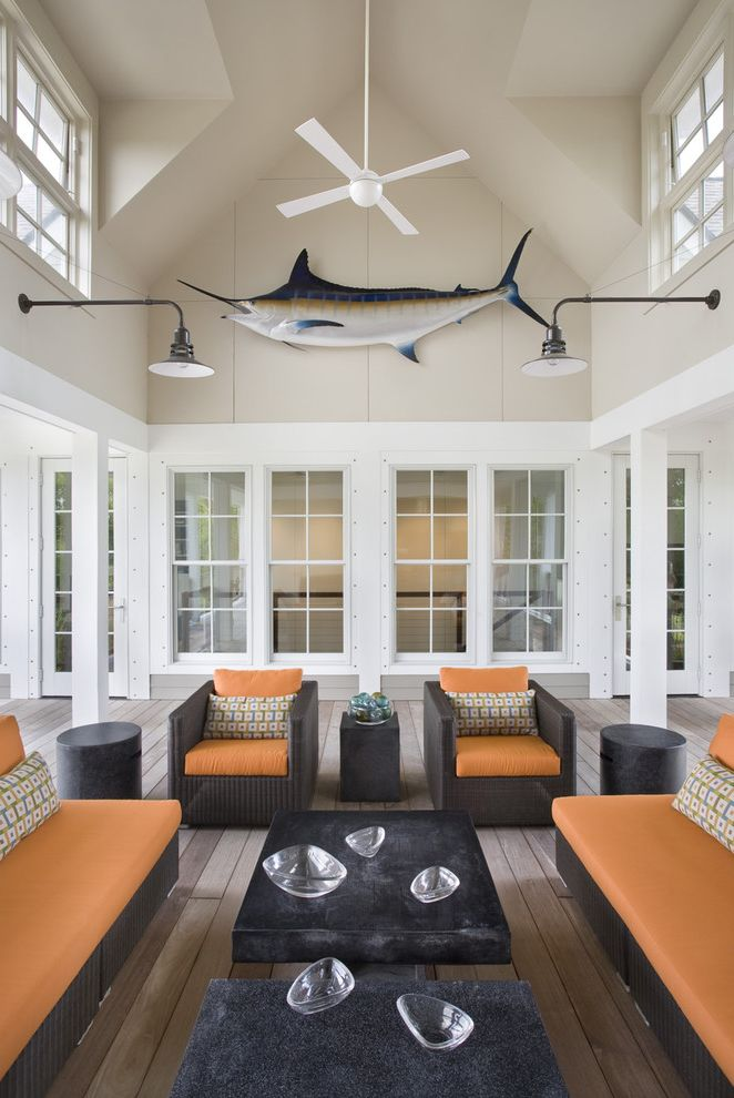 Marlins Furniture   Contemporary Porch  and Clerestory Deck Enclosed Porch Lanterns Marlin Orange Cushions Outdoor Lighting Patio Furniture Vaulted Ceiling White Trim Wicker Furniture