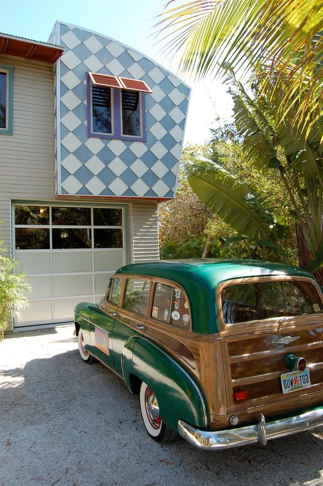 Menards Moving Boxes   Eclectic Exterior  and Artistic Awning Checkerboard Colorful Creative Cladding Fun Funky Garage Door Gravel Drive Gray Lap Siding Light Blue Tropical Plants Vintage Car White