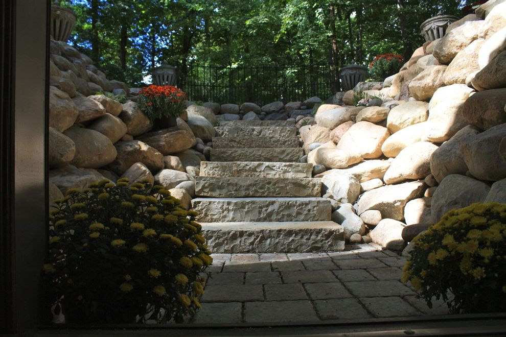 Michigan Landforms with Traditional Landscape  and Boulder Walls Decomposed Granite Natural Cut Stone Steps Pavers Walkout Basement