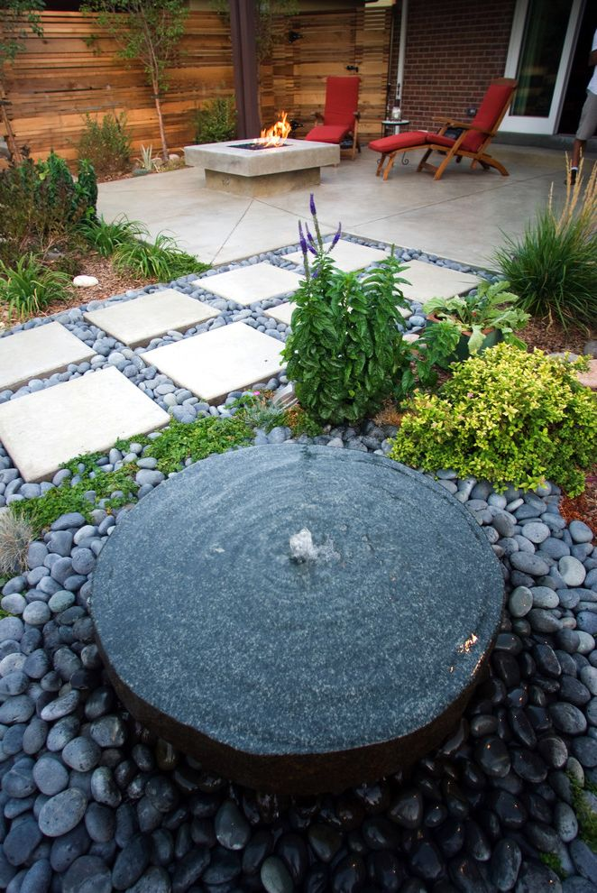 Mile High Ministries   Contemporary Landscape  and Black Stones Brick Exterior Fire Pit Fountain Mill Stone Modern Water Feature Plants Red Seat Cushions Smooth Stones Walkway Wood Fence
