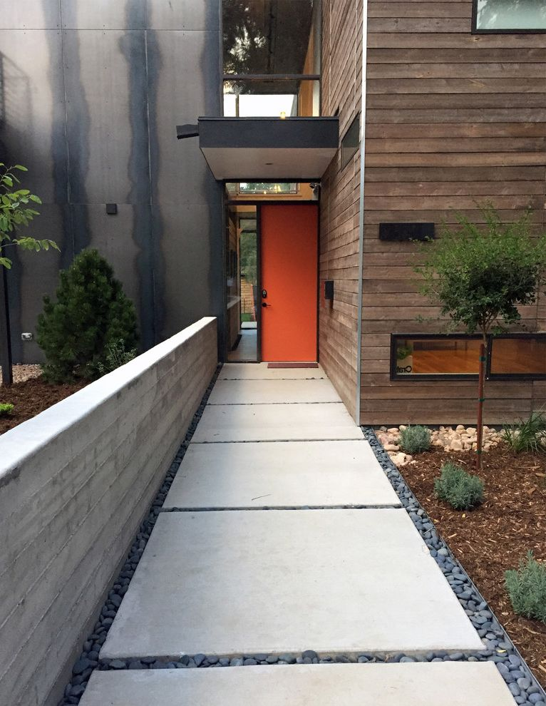 Mile High Ministries with Contemporary Entry Also Concrete Pavels Dark Wood Siding Entry Window Orange Door Pebbles